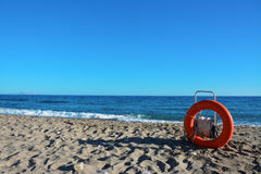 A life preserver on a beach. In a sunny day Royalty Free Stock Images