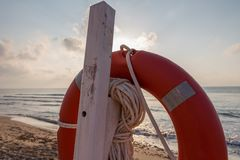 Life preserver on a beach at sunrise. Guardamar del segura, Spain, Europe Stock Photo