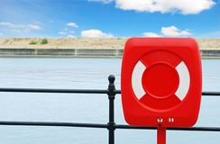 Life preserver on black iron fence. Closeup of a red life preserver on black iron fence Stock Images