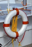 Life preserver on a boat. Life preserver and rope hanging from the railing of a boat Royalty Free Stock Photography