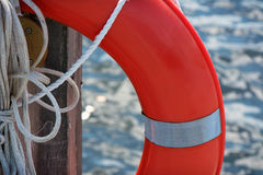Life preserver close up. A close up of a life preserver with water in the background. Room for copy Royalty Free Stock Photo