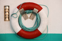 Life Preserver. Closeup view of life preserver hanging on  boat wall Stock Photos