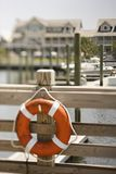 Life preserver on dock Stock Photo