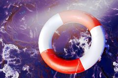 Life Preserver floating. In rough waters Stock Photos