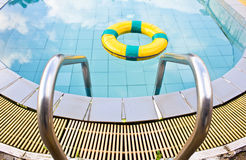 Life preserver floating. In a  swimming pool Royalty Free Stock Images