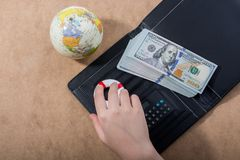Hand holding life preserver beside dollar banknotes, calculator stock photo