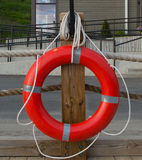 Life Preserver hanging on a wooden post Royalty Free Stock Photo
