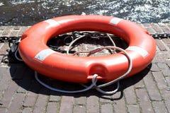 Life preserver. Orange life preserver on wharf Royalty Free Stock Image