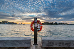 Life Preserver on pole with sunset in background Royalty Free Stock Image