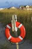 Life preserver on post. Life preserver hanging on post on beach Stock Image