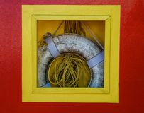 Life preserver and rope hanging in box on dock Royalty Free Stock Photography
