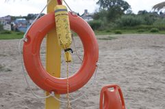 Life preserver on sandy beach. In Poland Stock Photo
