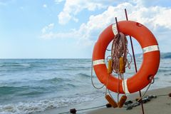 Life preserver on sandy beach somewhere in Black Sea.  royalty free stock photo