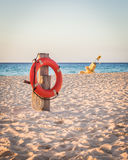 Life preserver on sandy beach Royalty Free Stock Photos