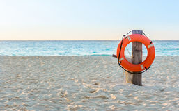 Life preserver on sandy beach Stock Images