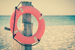 Life preserver on sandy beach Stock Photography