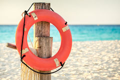 Life preserver on sandy beach. Somewhere in Mexico Royalty Free Stock Photos