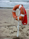 Life preserver on sandy beach. Somewhere in Mexico royalty free stock image