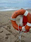Life preserver on sandy beach. Somewhere in Mexico stock photo