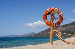 Life preserver on sandy beach somewhere near at sea.  Stock Images