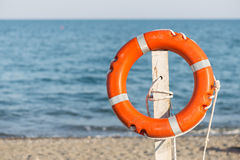 Life preserver on sandy beach. View of one life preserver on sandy beach Royalty Free Stock Images