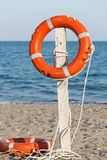 Life preserver on sandy beach. View of two life preserver on sandy beach stock photo