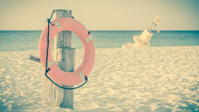 Life preserver on sandy beach Royalty Free Stock Photo