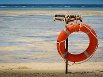 Life preserver at sea. Life preserver with red sea in the background Stock Images