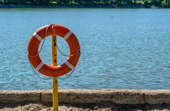 Life preserver on the shore of the lake to rescue drowning. A life preserver on the shore of the lake to rescue drowning Royalty Free Stock Photos