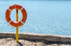 Life preserver on the shore of the lake to rescue drowning. A life preserver on the shore of the lake to rescue drowning Stock Images