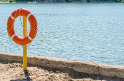 Life preserver on the shore of the lake to rescue drowning. A life preserver on the shore of the lake to rescue drowning Royalty Free Stock Image