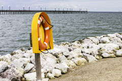 Life Preserver. A life preserver sitting in a case near the coastal edge Royalty Free Stock Photography
