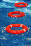 Life preservers in pool Stock Photography