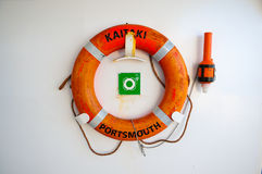 Life preservers on white wall. Life buoy on the deck of cruise ship. Stock Photos