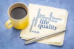 Life quality concept - napkin word cloud. Life quality concept - handwriting on a napkin with a cup of espresso coffee stock photography