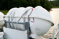 Life Raft. A life raft on the side of a boat ready for deployment royalty free stock photos