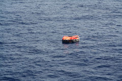 Life Raft adrift on the Ocean. Isolated Life Raft adrift on the Ocean Stock Photography