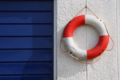 Life ring. Life saving ring hanging on wall Royalty Free Stock Photos