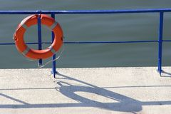 Life Ring. On blue fence near the water Stock Photography