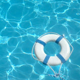 Life ring. Floating on top of sunny blue water Royalty Free Stock Photography
