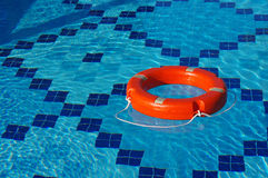 Life Ring on blue water. Stock Photo