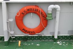 Life ring on board of ship S.S. Hellas Liberty in haven of Piraeus. Greece royalty free stock images
