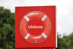 Life ring. A bright orange life buoy ring signboard stock photos