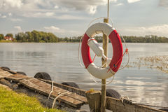 Life ring by lake Stock Photo