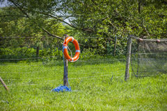 Life ring on a post. A buoyancy life ring hung up ready to help somebody in distress Stock Photos