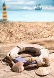 Life ring and seashells Royalty Free Stock Photography