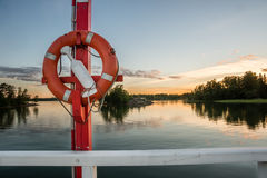 Life ring on sunset time in Seurasaari Helsinki Royalty Free Stock Images