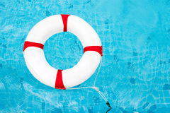 Life Ring at the swimming pool. Life Ring on water. Life Ring on. Blue water Royalty Free Stock Photos