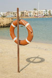 Life ring on a tropical beach Royalty Free Stock Image