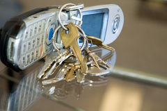 Life on the run. Cell phone with keys royalty free stock image